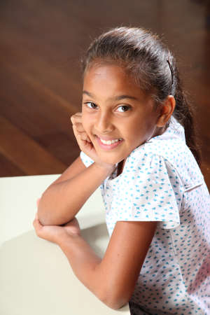 Portrait of happy school girl with beautiful smile Stock Photo - 9568326