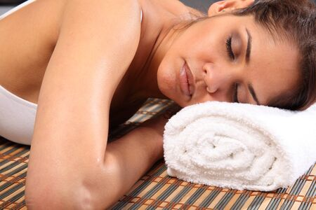 Beautiful woman totally at rest in health spa photo