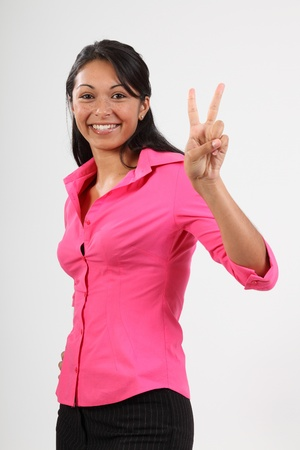 Number two gesture from beautiful woman in pink photo