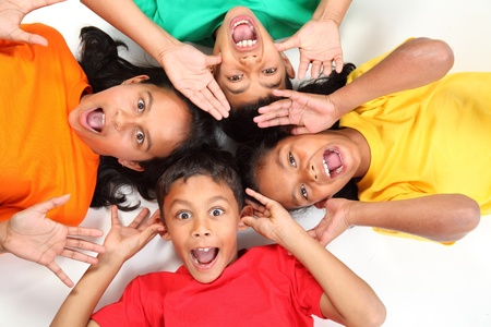 Funny faces from four young school friends Stock Photo - 9568723