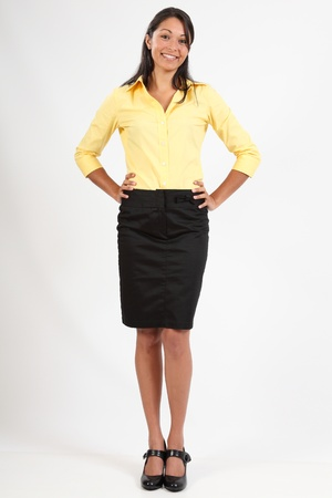 woman standing: Beautiful young woman in business blouse and skirt
