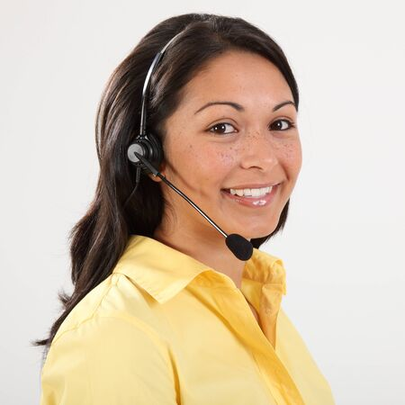 Beautiful smiling receptionist on the telephone photo
