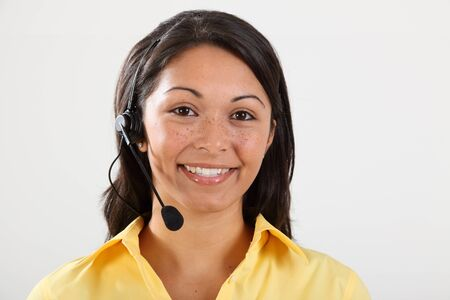 Smiling friendly receptionist on the telephone photo