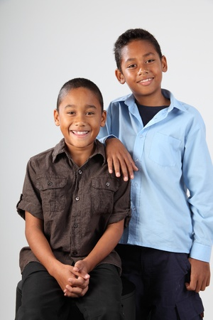 nine years old: Studio portrait of two young boys