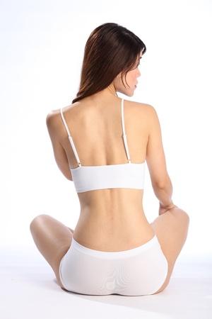 Back view of healthy body of an oriental girl in underwear photo