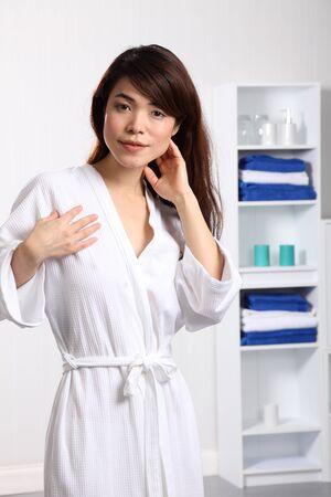 Beautiful oriental woman in bath robe photo