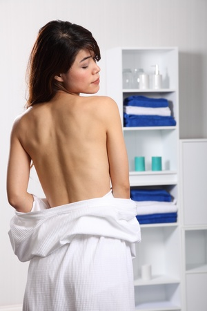 Beautiful healthy oriental woman shows naked back photo