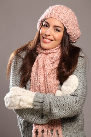 mitten: Big happy smile by beautiful woman in warm clothes