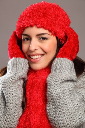 close knit: Happy smile by woman in warm festive woolly knits Stock Photo