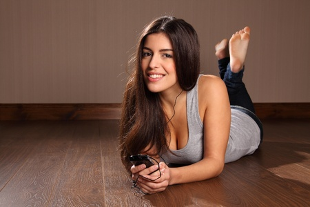 Young woman enjoying music on her smart phone Stock Photo - 9568432