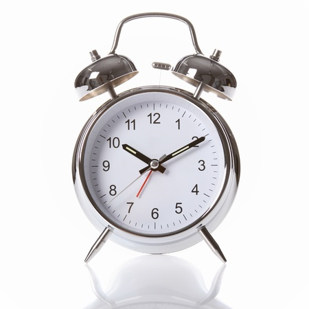 alarm clock: Traditional silver and chrome alarm clock, with big clear numerals and two alarm bells on top.