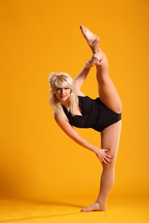 Dancer doing standing splits photo