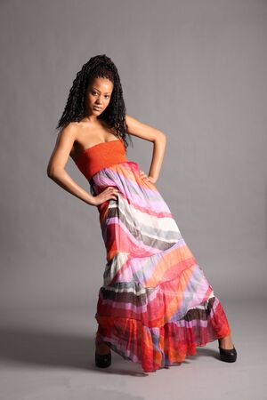 Sexy young African model wearing colourful dress photo