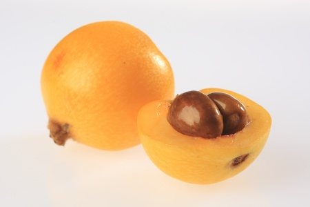 plum island: Loquat fruit with seeds also known as Japanese plums