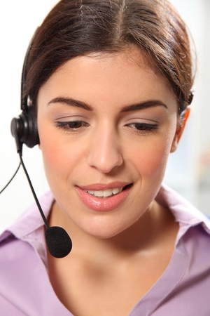 glancing: Telephone operator using headset glancing down