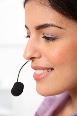 Profile young female receptionist wearing headset photo