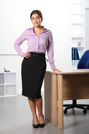Beautiful business woman standing in the office photo