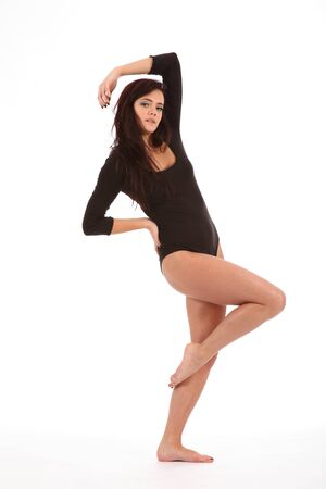 Dancing pose by beautiful young girl in leotard Stock Photo - 9642512