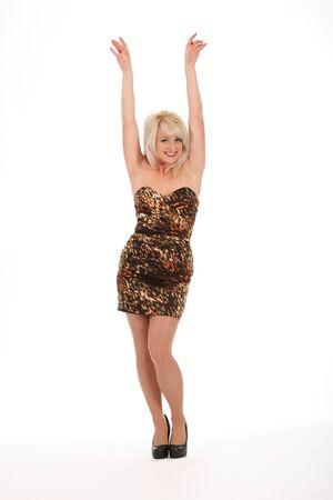 vestido corto: Armas de chica sexy rubia plantearon en definitiva vestido Foto de archivo