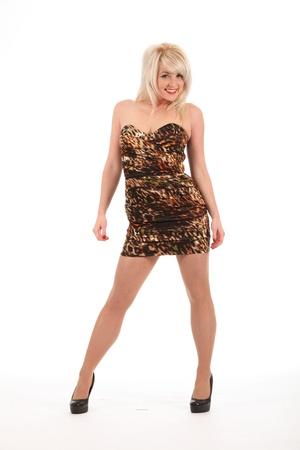 vestido corto: Chica rubia feliz sexy en tacones y vestido corto
