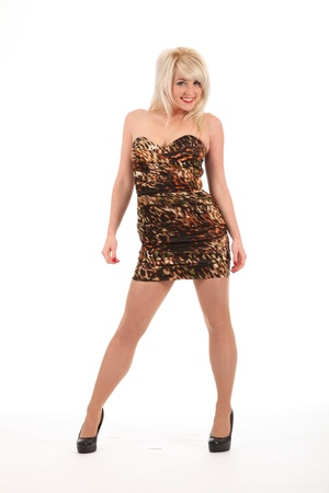 Sexy happy blonde girl in heels and short dress photo