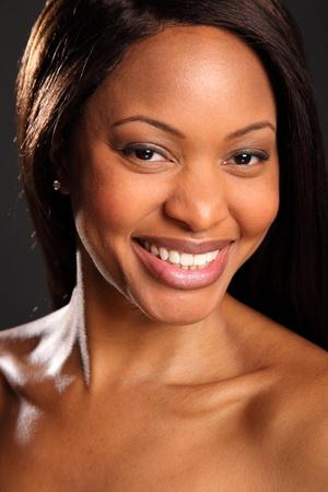 woman black background: Big happy smile on beautiful black woman Stock Photo
