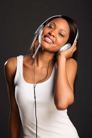 Beautiful happy black woman enjoying music photo
