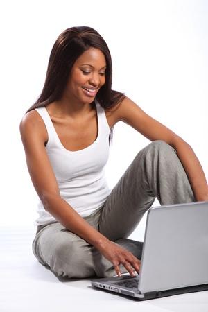 african background: Beautiful black woman using laptop big smile