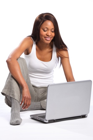 Black woman sitting on floor using laptop Stock Photo - 9642553
