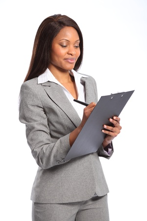 business woman standing: Beautiful black business woman with clipboard