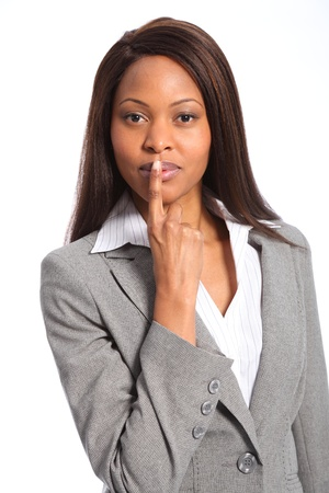 Quiet signals beautiful black woman with finger on lips photo