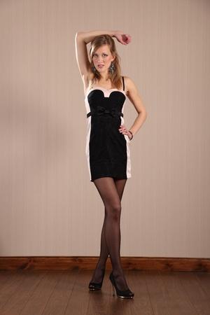 black stockings: Long legs sexy fashion model poses in short dress Stock Photo