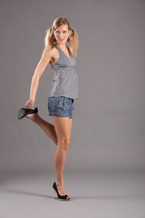 Sexy blonde fashion model in heels and shorts Stock Photo - 9642564