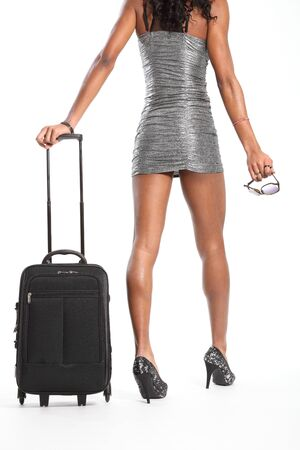 Sexy long legs of woman walking with suitcase photo