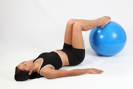 knees bent: Athletic sports woman knees bent on exercise ball