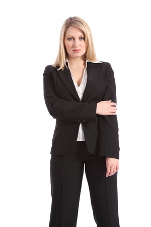 Confident and serious in business suit, a beautiful young blonde business woman, standing looking straight to camera. photo