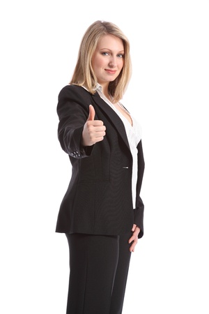 Confident and positive young, beautiful blonde business woman gives thumbs up sign. She is wearing a smart black business suit. photo