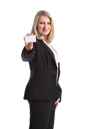 Confident and positive young, beautiful blonde woman holds up a business card. She is wearing a smart black business suit. photo