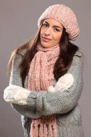 Beautiful young woman in warm winter knit wear photo