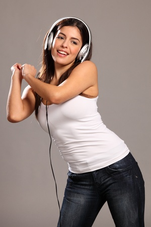 Beautiful girl dancing to music photo