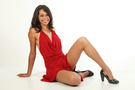 girl in red dress: Big smile from beautiful girl wearing red dress Stock Photo