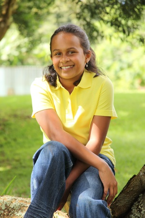 shady: Young girl sitting under a shady tree