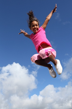 ethnic children: Sky is the limit for joyful young school girl