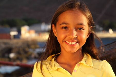 Cutest smile in late afternoon light from young school girl photo