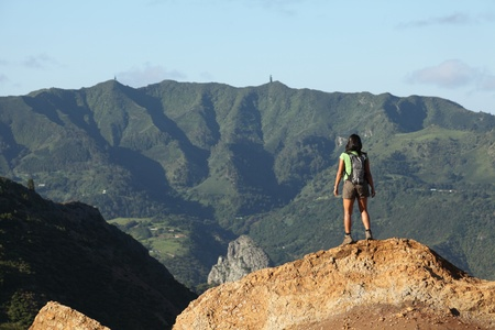 helena: Woman hiker viewing central peaks on St Helena