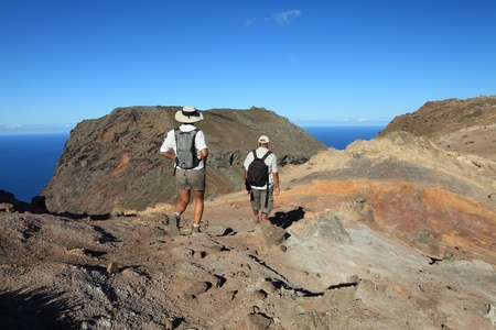 Couple hiking on top volcanic craters on St Helena photo