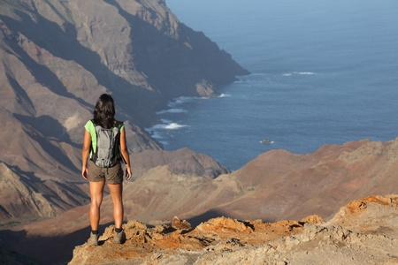 Woman hiking on top volcanic craters on St Helena photo