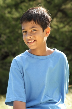 Smiling young boy in countryside sunshine photo