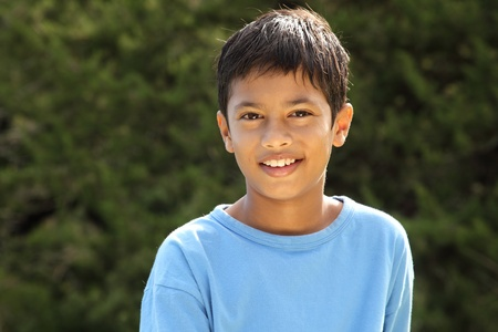 Happy smiling young boy in countryside sunshine photo