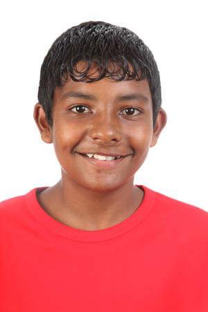 Smiling teenage boy in studio wearing a red t shirt Stock Photo - 9745417